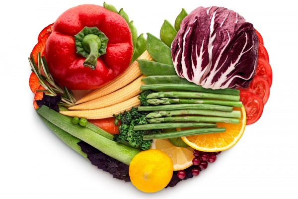 Healthy food concept of a human heart made of vegetable mix that reduce death risk, isolated on white.
